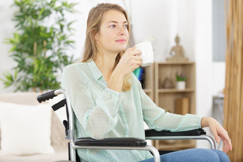 Woman drinking coffee on wheelchair. Woman drinking coffee on a wheelchair stock images