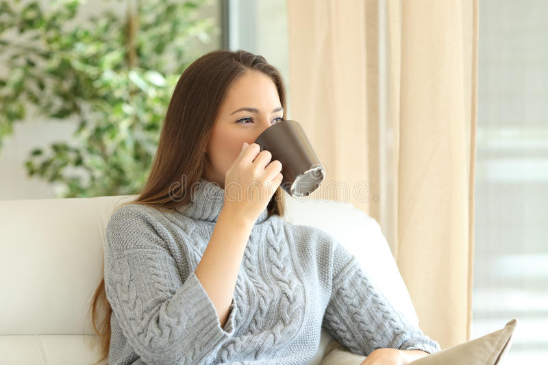 Download Woman Drinking Coffee In Winter Stock Image - Image of face, female: 81727077