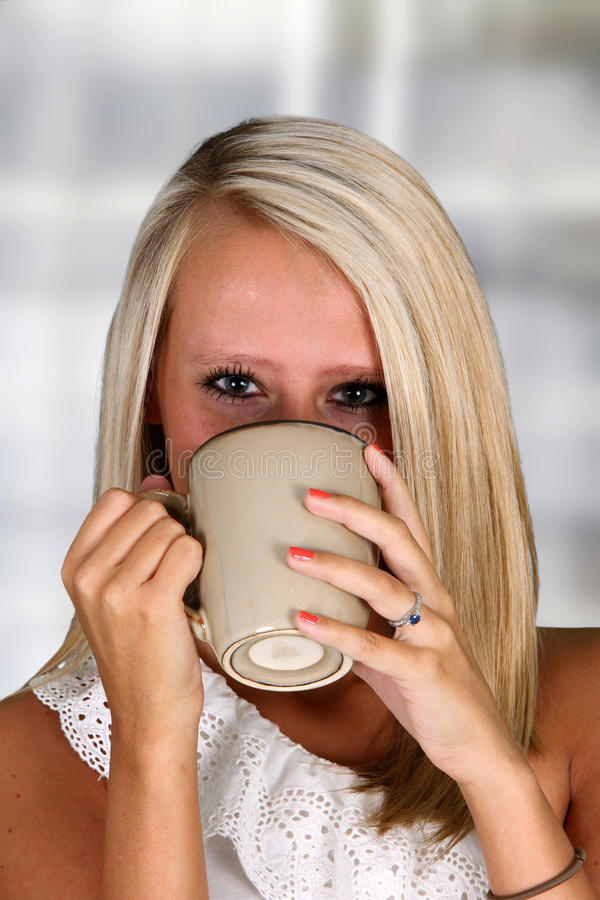 Woman Drinking Coffeee