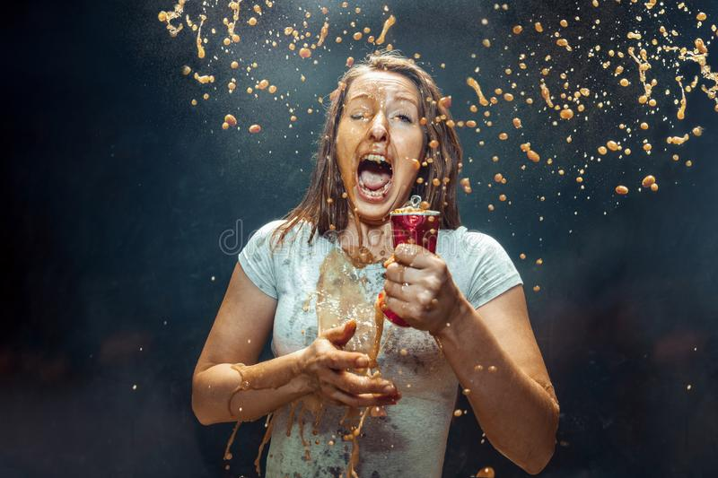 Woman drinking a cola royalty free stock image