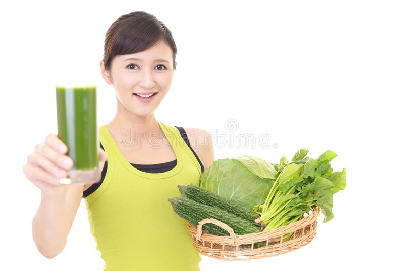 Woman with a glass of vegetable juice. Woman drinking a glass of vegetable juice stock photo