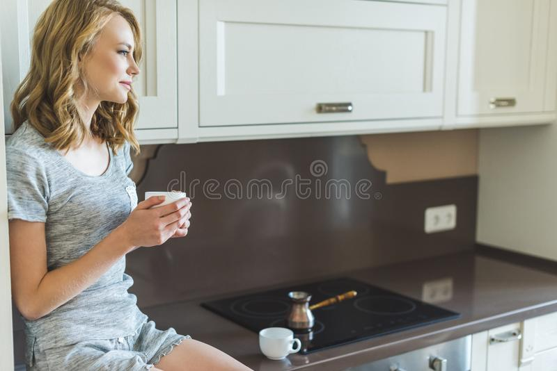 Woman drinking her morning coffee stock images