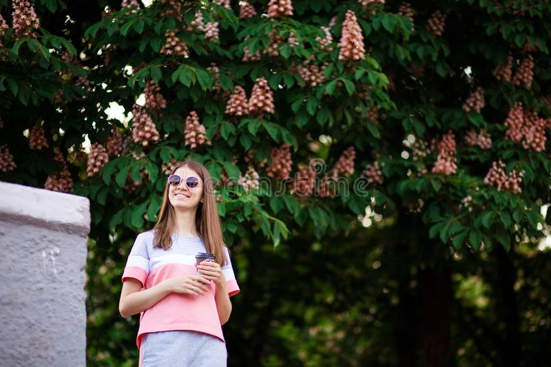 Woman drinking hot coffee outdoor enjoying nature during holiday in summer day with chestnut on background stock photos