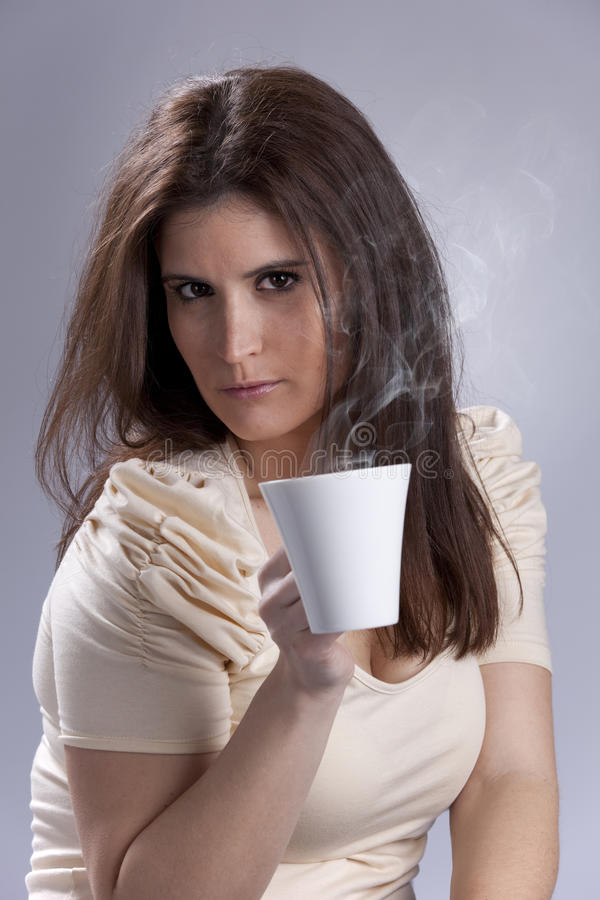 Woman drinking a hot drink. Beautiful woman portrait holding a mug with some hot drink stock photos