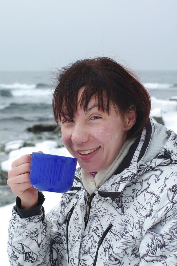 Woman is drinking hot tea stock photos