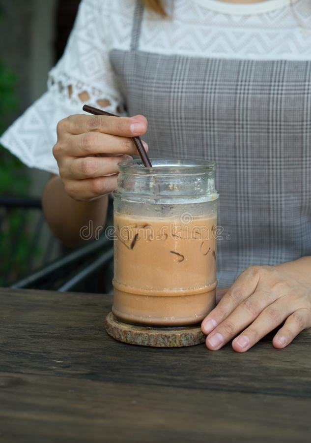 Woman drinking iced coffee,food and drink. Woman drinking iced coffee,food and beverage royalty free stock photo