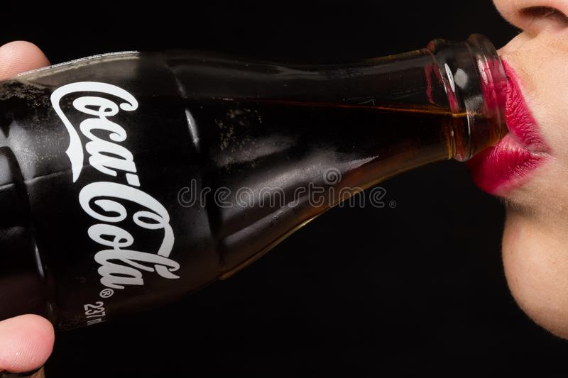 Woman Drinking 237 Ml. Coca-cola royalty free stock photo