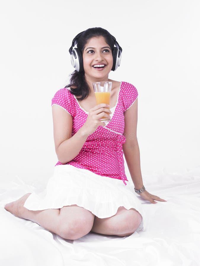 Download Woman Drinking Orange Juice Royalty Free Stock Photos - Image: 7386448