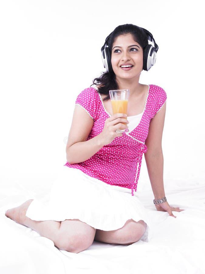 Woman Drinking Orange Juice Stock Photos