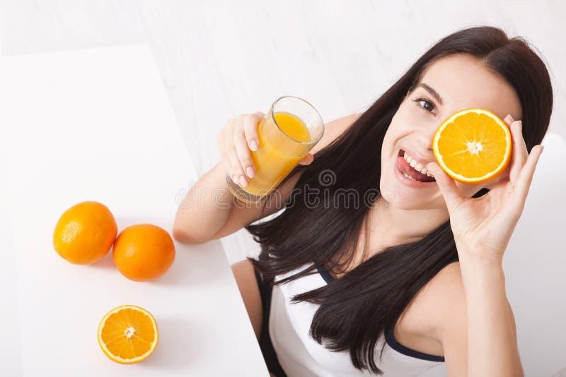 Woman drinking orange juice Beautiful mixed-race Asian, Caucasian model. royalty free stock photography