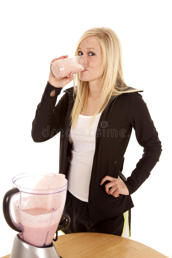 Download Woman Drinking Smoothie By Table Stock Image - Image of blond, beauty: 18501075