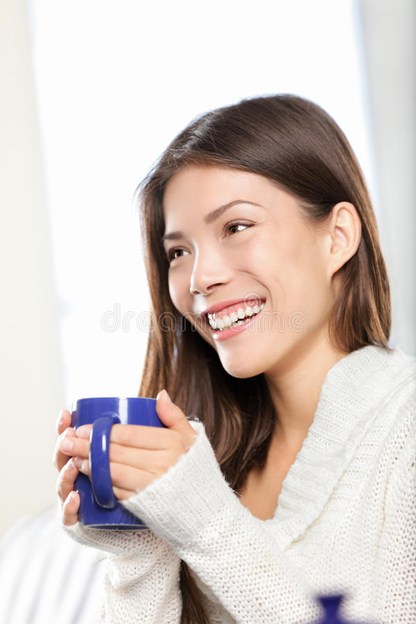 Download Woman drinking tea stock photo. Image of couch, cafe - 22028896