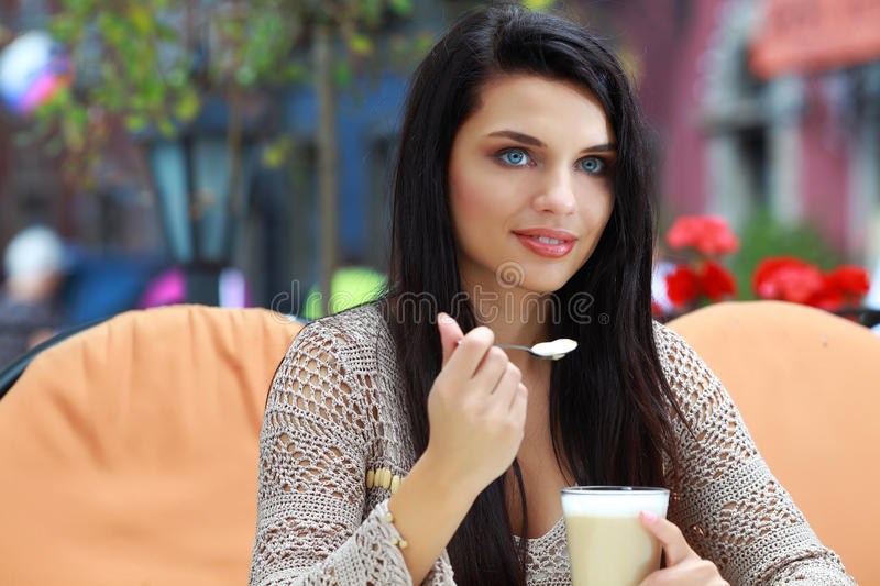 Download Woman Drinking Tea In A Cafe Outdoors Royalty Free Stock Photo - Image: 11089075