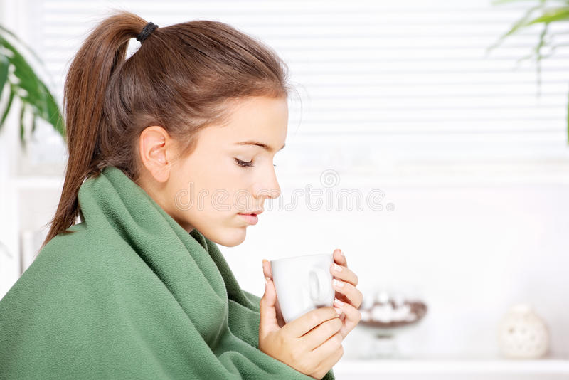 Download Woman Drinking Tea  At Home Covered With Blanket Stock Image - Image: 27443209