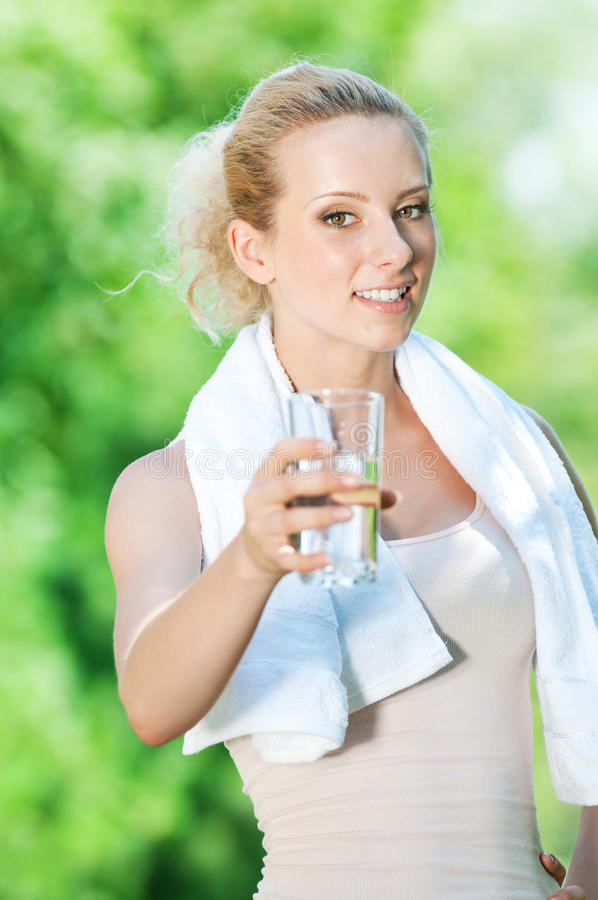 Download Woman Drinking Water After Exercise Stock Image - Image of motion, healthcare: 21561721