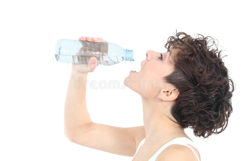 Woman drinking water from a plastic bottle. On a white isolated background stock photos