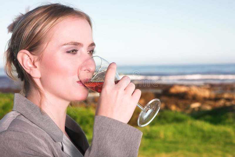 Woman drinking wine royalty free stock image