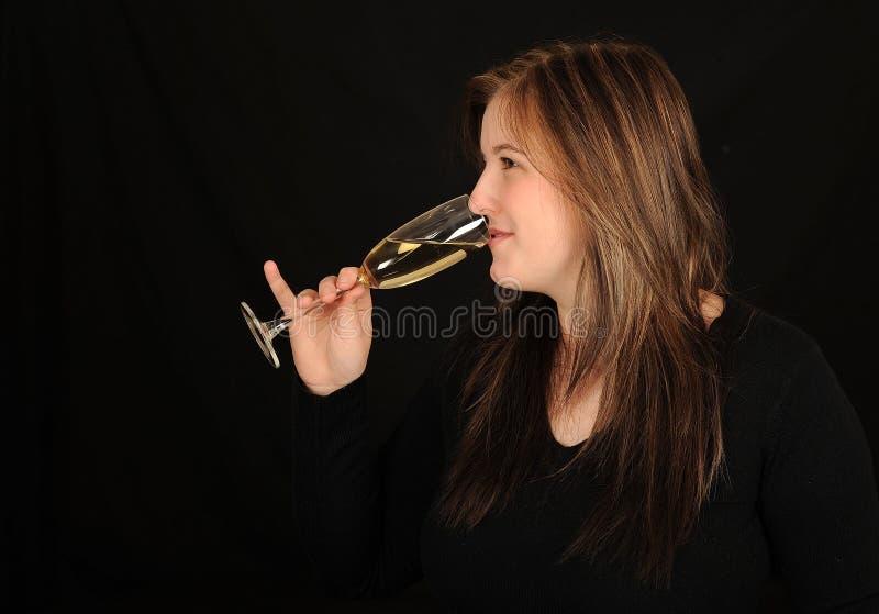Woman drinking wine stock image
