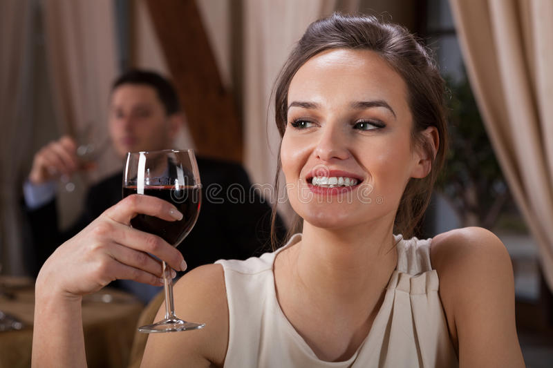 Woman drinking wine in restaurant royalty free stock photo