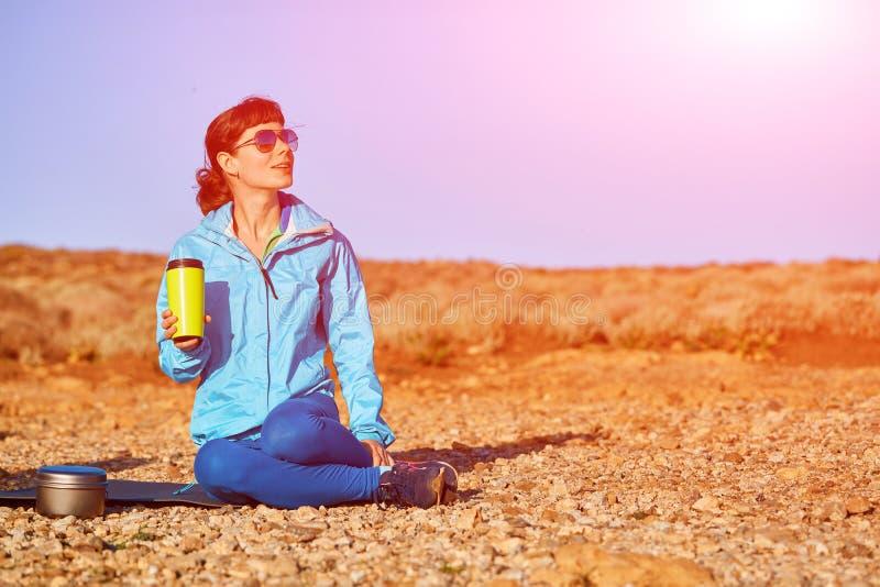 Woman drinks coffe royalty free stock photo