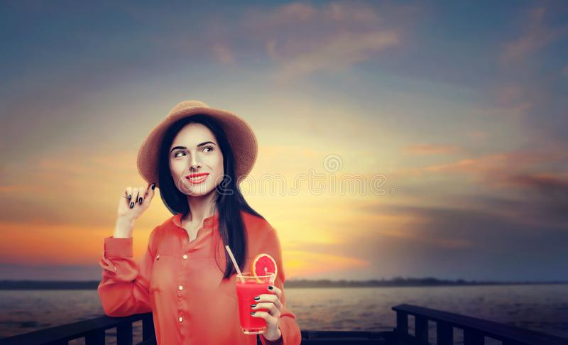 Woman drinks fresh juice fruit royalty free stock photography