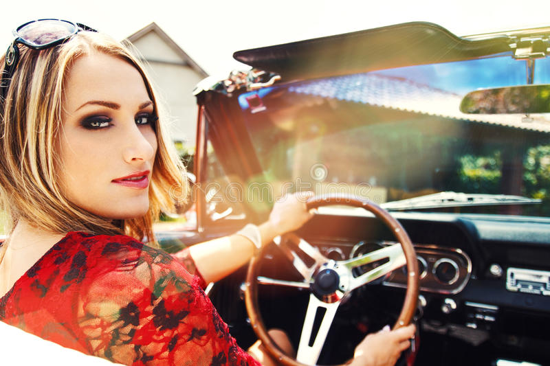 Woman drive in sunset stock images