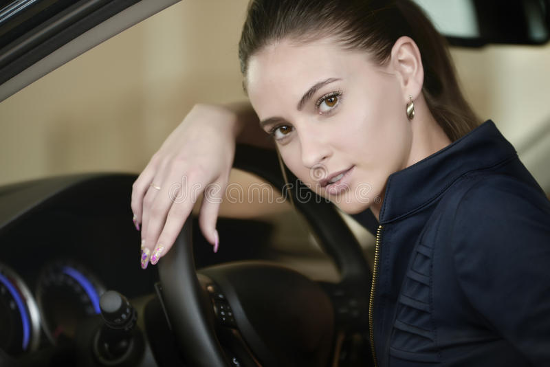 Woman driver in car portrait royalty free stock photography