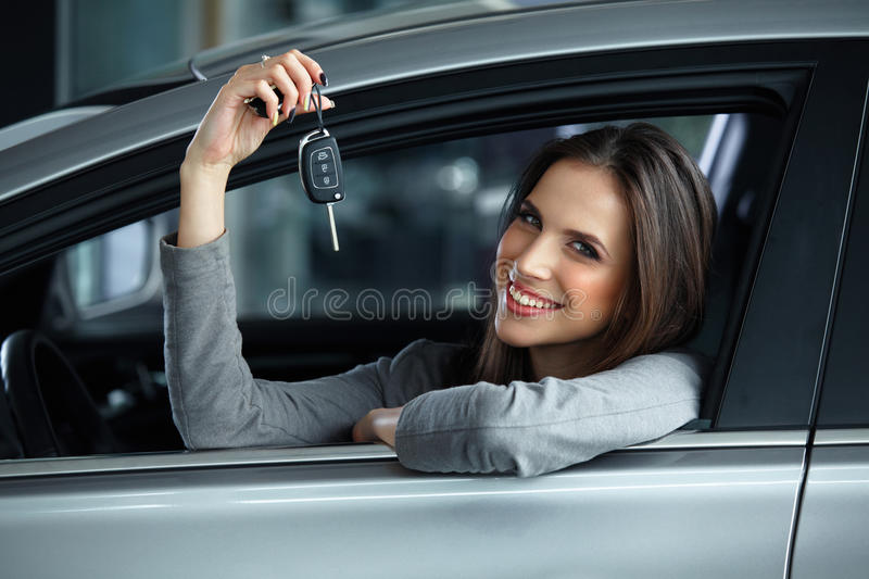 Woman Driver Holding Car Keys siting in Her New Car. Woman Driver Holding Car Keys siting in Her New Car stock photos