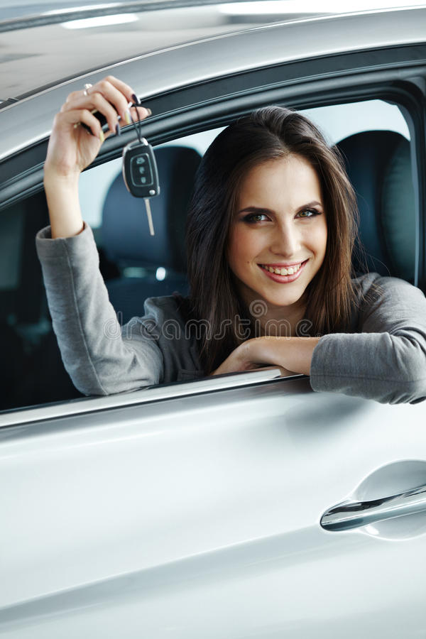 Woman Driver Holding Car Keys siting in Her New Car. Woman Driver Holding Car Keys siting in Her New Car royalty free stock photo