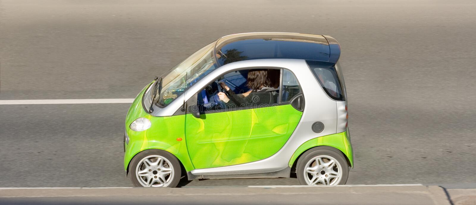 Woman drives clever smart mini stock photos