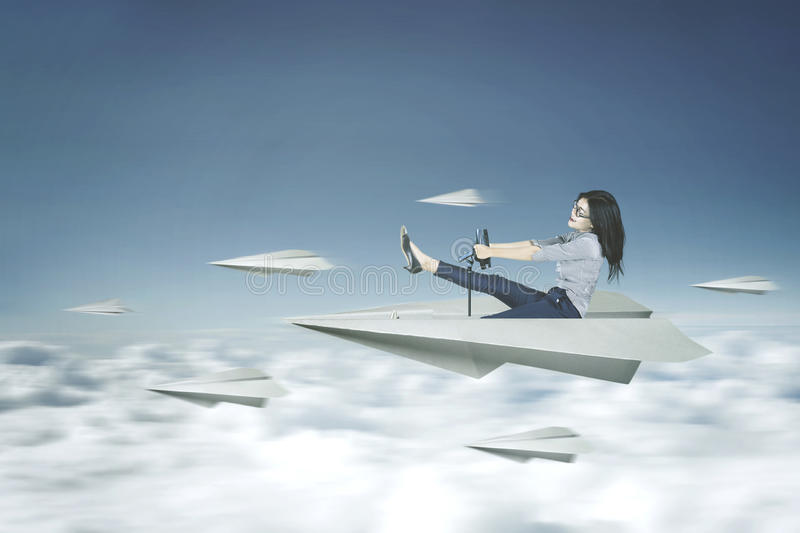 Woman drives a paper plane royalty free stock photos