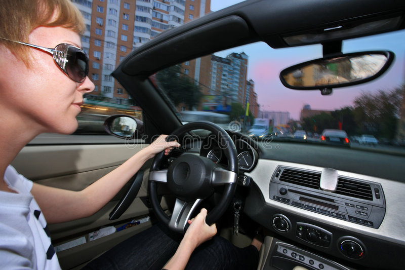 Woman driving car royalty free stock photography