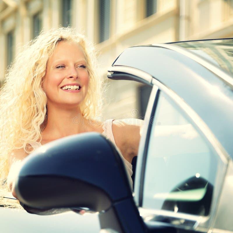 Woman driving car - female driver stock photo