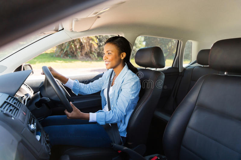 Woman driving car stock photography