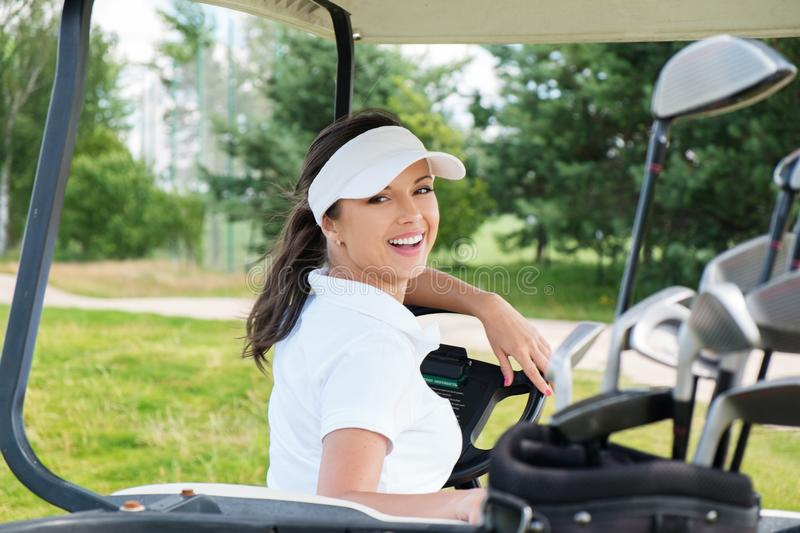 Woman driving golf cart stock images