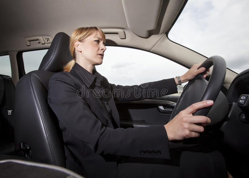 Woman driving her car royalty free stock photos