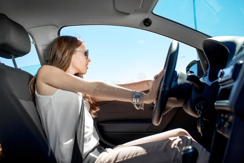Woman driving her car stock photography