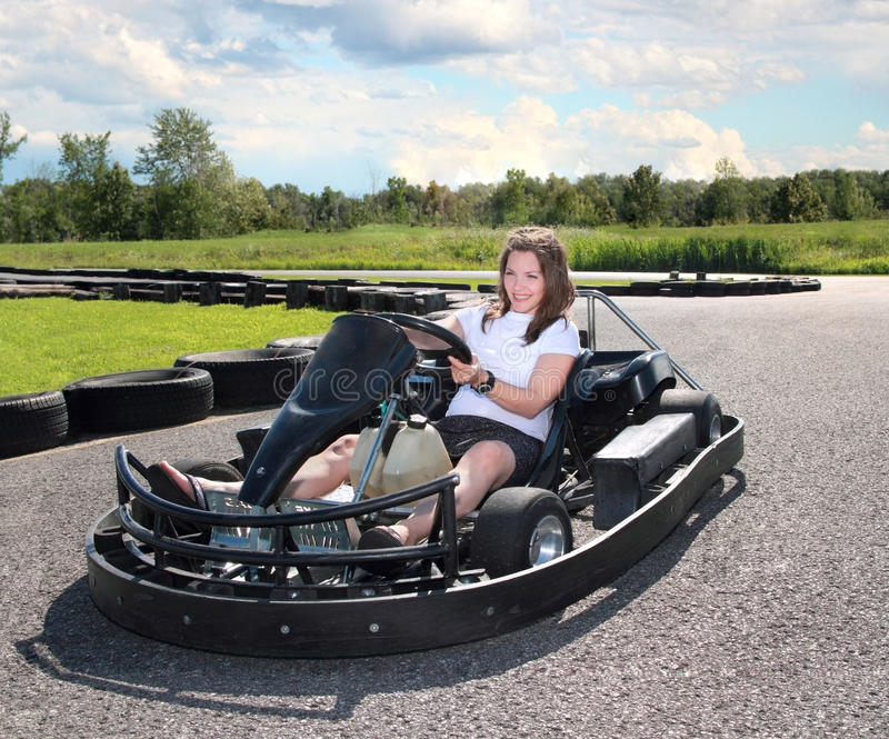 Woman driving. A kart during summer royalty free stock images