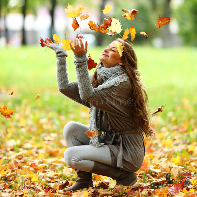 Download Woman Drop Leaves In Autumn Park Royalty Free Stock Images - Image: 26238679