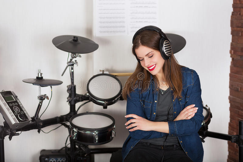 Woman drummer practicing at home stock photography