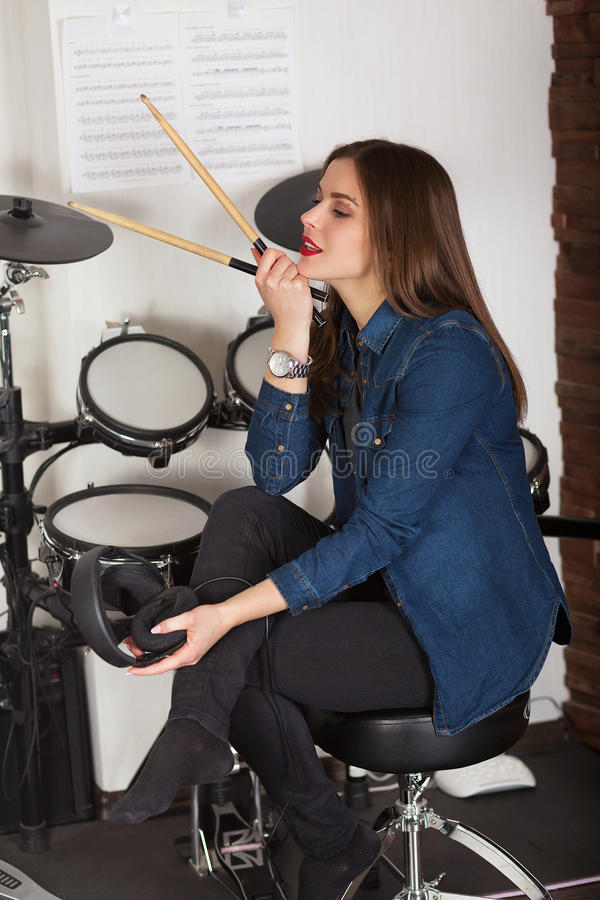 Woman drummer practicing at home stock photo