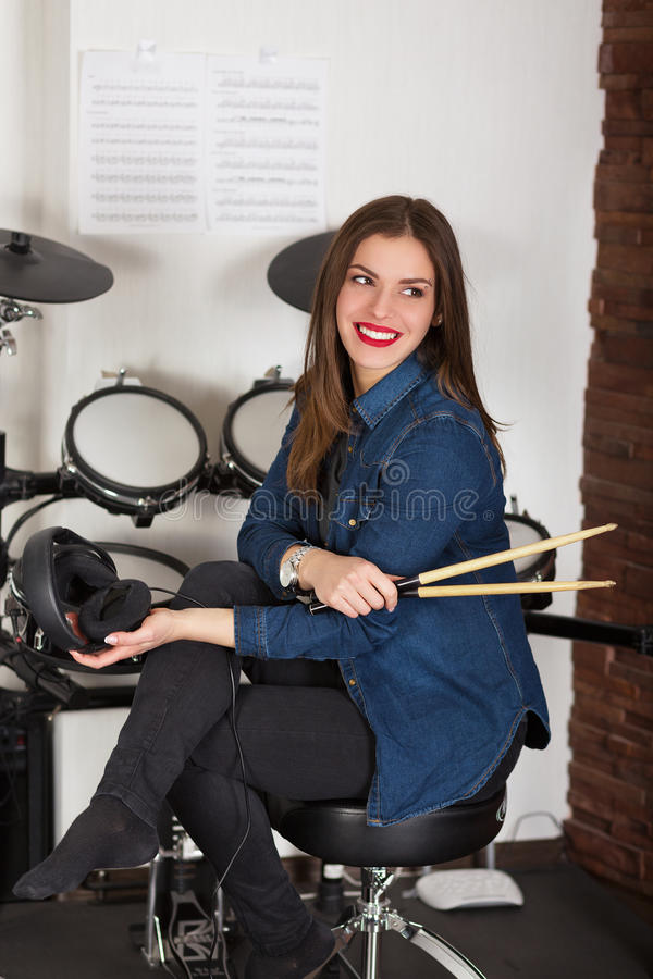 Woman drummer practicing at home royalty free stock photography