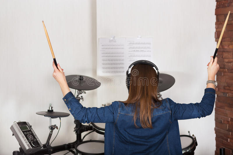 Woman drummer practicing at home royalty free stock photo