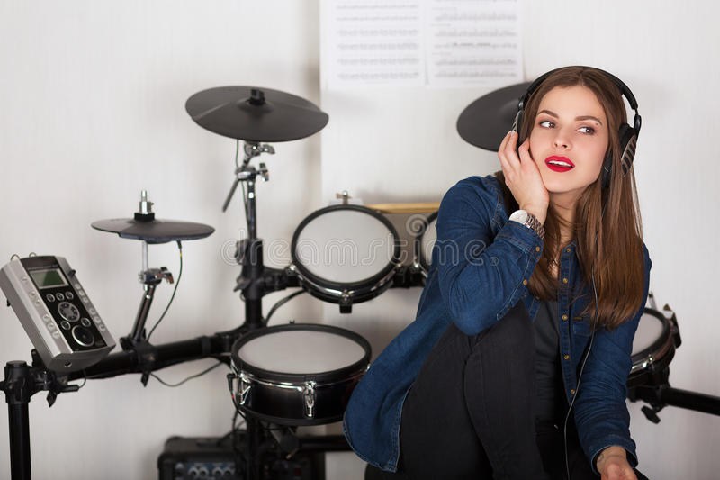 Woman drummer practicing at home royalty free stock photos