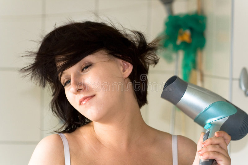 Woman with dryer royalty free stock photos