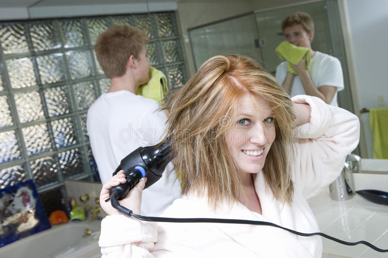 Woman Drying Her Hair In Bathroom Royalty Free Stock Images