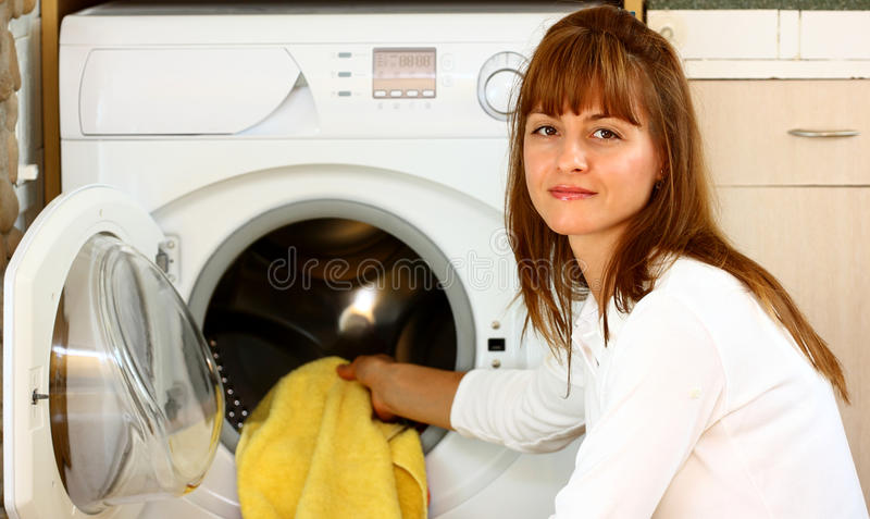Woman duing laundry royalty free stock image