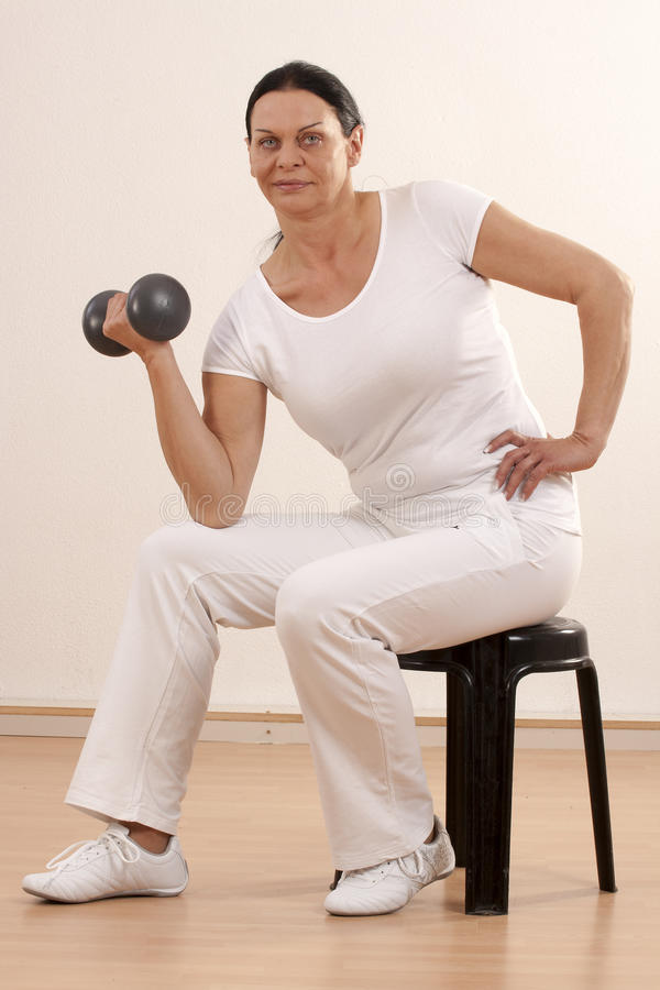 Download Woman with dumbbell stock image. Image of finess, medicine - 24527037