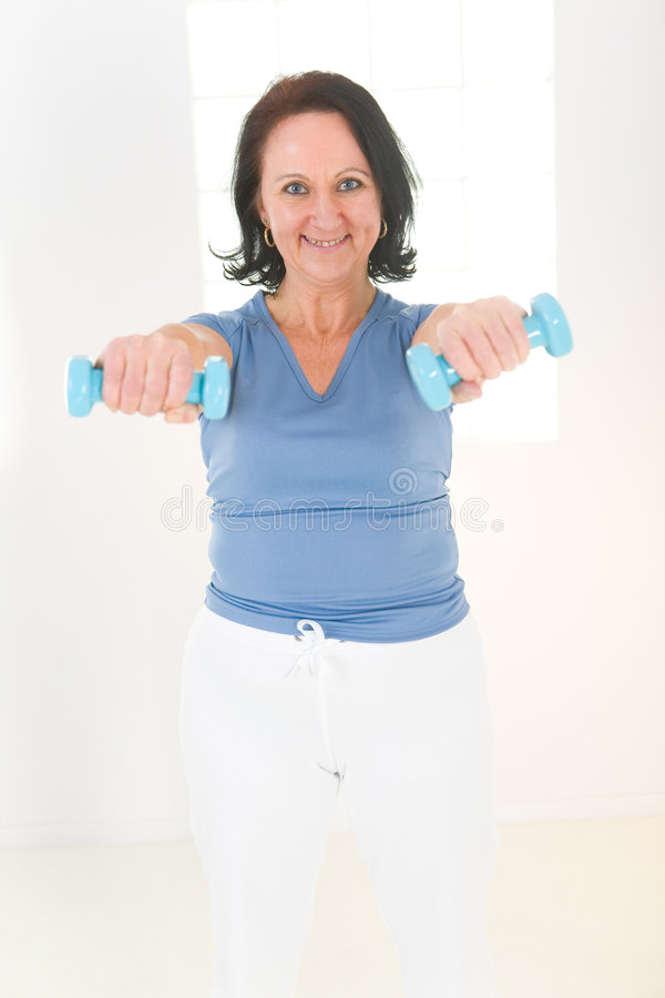 Download Woman With Dumbbell Royalty Free Stock Images - Image: 8869329