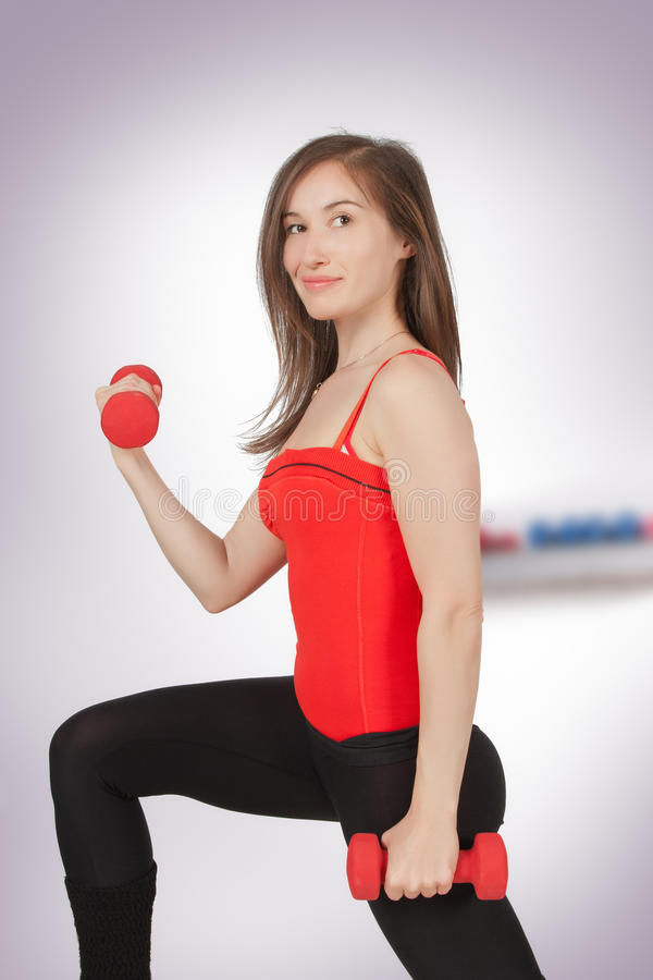 Download Woman With Dumbbell In Hand Stock Image - Image: 24292947